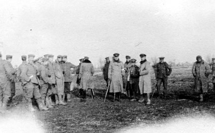 British and German soldiers meet in No-Man's Land during the unofficial Christmas truce of WWI