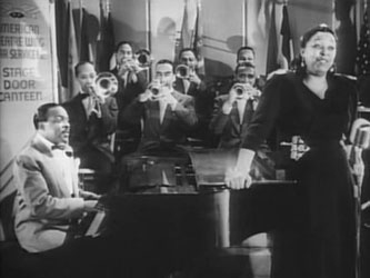 Count Basie with his band and singer Ethel Waters in the film State Door Canteen, 1943