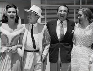 In Hollywood, Porter with Ann Miller, Jack Cummings, and Kathryn Grayson.